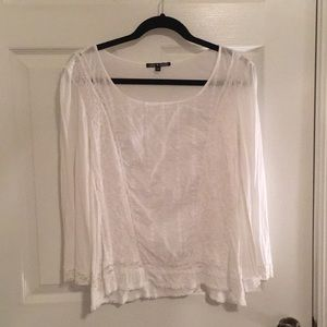 Sheer long sleeve white blouse with lace detail.
